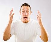 Man gesturing in surprise — Stock Photo