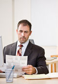 Businessman reviewing paperwork — Stock Photo