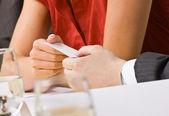 Businesswoman handing co-worker her business card — Stock Photo