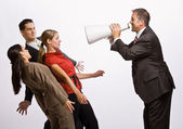 Businessman shouting at co-workers with megaphone — Stock Photo