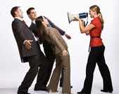 Businesswoman shouting with megaphone — Stock Photo