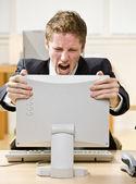 Businessman shouting at computer — Stock Photo