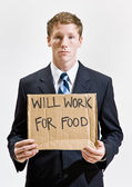 Businessman with sign ill work for food — Stock Photo