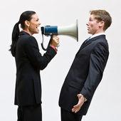 Businesswoman using megaphone — Stock Photo
