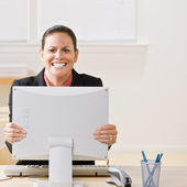 Businesswoman shaking monitor — Stock Photo