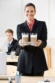 Businesswoman carrying tray of coffee — Stock Photo