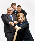 Business playing tug-of-war — Stockfoto