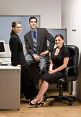 Co-workers sitting in office cubicle — Stock Photo
