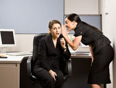 Co-workers gossiping — Stock Photo