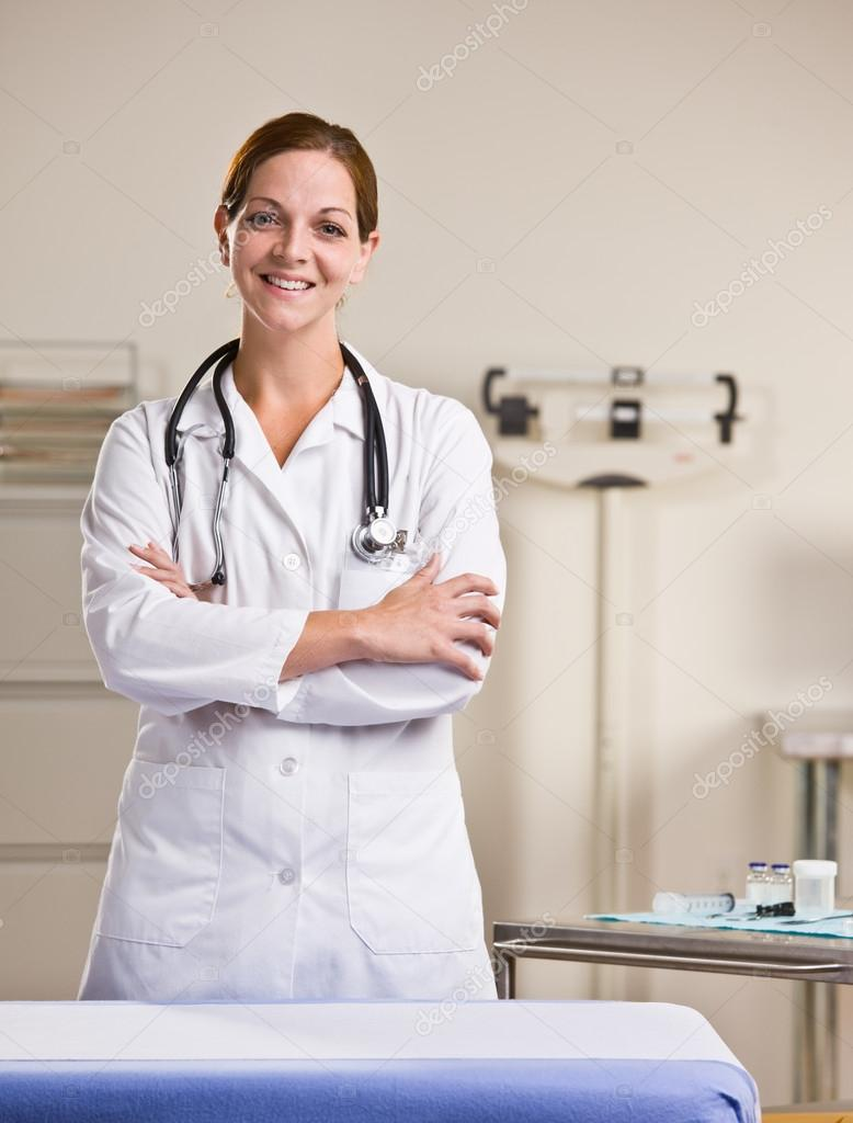 Doctor in lab coat in doctor office — Stock Photo #18790961