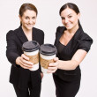 Businesswoman toasting with coffee cups — Stock Photo