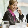 Businesswoman Smiling with Cell Phone — Stock Photo