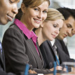 Businesswoman at Meeting Smiling — Stock Photo #18800531