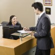 Businessman and Receptionist — Stock Photo #18800631