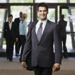 Royalty-Free Stock Photo: Young Businessman Smiling