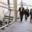 Business Traversing Stairs — Stock Photo