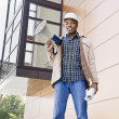 Male Construction Worker With Bullhorn - Stock Photo