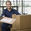 Young Woman Moving Boxes - Stock Photo