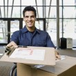 Young Man Delivering Boxes — Stock Photo