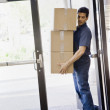 Young Man Delivering Boxes — Stock Photo #18801491