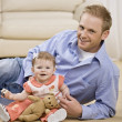 Young Man and Child Smiling — Stock Photo #18801649