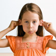 Young girl pulling ears - Stock Photo