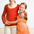 Stock Photo: Sisters hugging