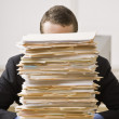 Businessman Behind Stack of File Folders — Stock Photo #18802059