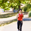 Woman running in park — Foto Stock