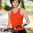 Woman on bike smiling — Stock Photo #18802723