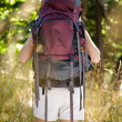Woman with backpack hiking — Photo