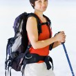 Woman hiking with backpack and walking stick — Stock Photo #18802775