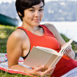 Woman reading book in park — Stock Photo #18802803