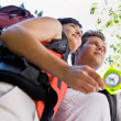 Couple with backpacks looking at compass — Stock Photo