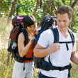 Womopening boyfriends backpack — Stockfoto #18802849