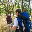 Couple hiking with backpacks — Zdjęcie stockowe #18802851