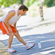 Runner stretching — Stock Photo