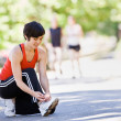 Stock Photo: Runner tying shoes