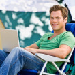 Camper using laptop — Stock Photo