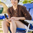 Camper text messaging on cell phone — Stock Photo #18802999