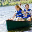 Stock Photo: Couple rowing boat