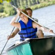 Couple rowing boat — Stock Photo