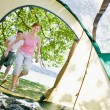 Couple running to tent - Stock Photo