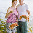 Stock Photo: Couple holding crab and trap