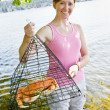 Woman holding crab in trap — Stock Photo #18803235