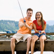 Couple fishing on pier — Stock Photo #18803345
