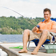 Man fishing on pier — Stock Photo