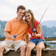 Couple fishing on pier - Foto Stock