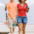 Couple fishing on pier — Stock Photo