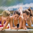 Friends text messaging with cell phone — Stock Photo #18803471